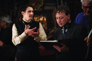 Actor James Franco and Director Sam Raimi on the set of Oz the Great and Powerful
