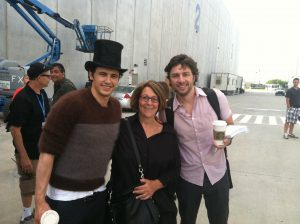 Andrea Raimi Rubin, sister of Sam Raimi, poses with actors James Franco and Zach Braff