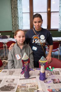 Tiushka Shaday Marquez Olivo, 9, with buildOn volunteer Lydia Maciel, 14, both of Detroit