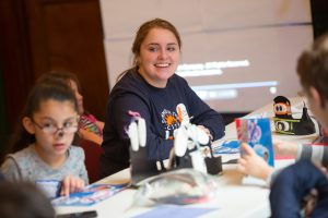 """J-Serve volunteer Abby Cohen, 16, of Farmington Hills works with a group on their """"country."""""""