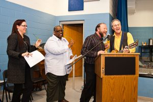 Joining in the singing: Kimberly Buffington of Mercyworks.org., Semmeal Thomas, senior pastor at City Covenant Church in Detroit, Rabbi Arnie Sleutelberg of Congregation Shir Tikvah and Steve Klaper of Oak Park.