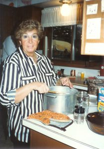 Ceil Liebman mixes matzah meal for popovers for a 1986 Passover meal.