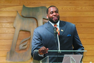 Kwame Kilpatrick, in happier times, speaks at the Birmingham Temple in February 2005.