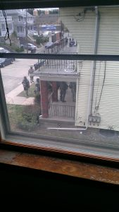 A view from Linda Echt's window of a SWAT team next door to check the house.