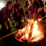 Roasting marshmallows was one of the fun events at the Lag b'Omer party at the Friendship Circle in West Bloomfield.