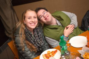 Yachad volunteer Alyssa Adler, 15, of Southfield with Danny Friedman, 25, of West Bloomfield at Yachad Detroit's weekly Parsha and Pizza program (Photos by Jerry Zolynsky)