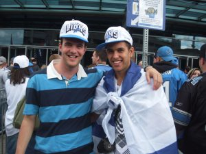 Bnei Akiva representatives Atai and Amots Amiram at Ford Field for a Lions game.