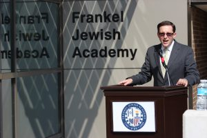 Rabbi Eric Grossman, head of school, speaks at the mezuzah dedication at the new entrance to Frankel Jewish Academy in West Bloomfield.
