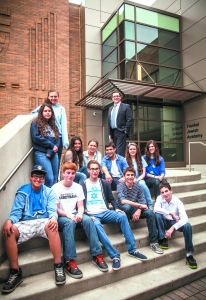 Rabbi Grossman with some FJA students at the new school entrance.