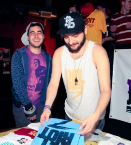 Brothers Jared and Evan Berman sell their F.you.N.K. products at a concert.