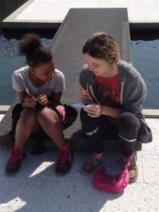"Alayna Brasch writes haikus with her Summer in the City ""buddy"" before a field trip to the Detroit Institute of Arts."