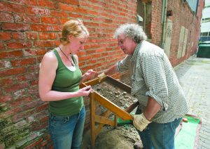 Brenna Moloney of Ann Arbor and Greg Young of Pleasant Ridge look at an artifact.