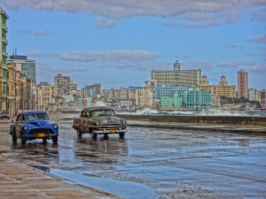 Old American cars are a Cuban staple. Here they drive along the Malecon, Havana's seawall.