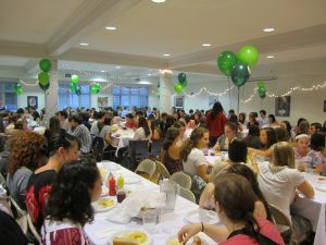 Hundreds of students gather at the MSU Hillel House for a Shabbat dinner.