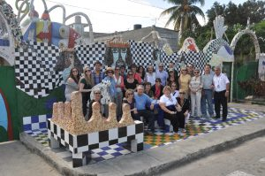 A tour group visits the colorful home, west of Havana, of famed Cuban artist Jose Fuester, known as the Picasso of the Caribbean