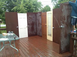 The Rosenzweig family built its first sukkah from recycled doors.