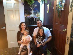 In the sukkah: Sarah and Benji Rosenzweig with Ellah, 2½, and Na'amah, 4.