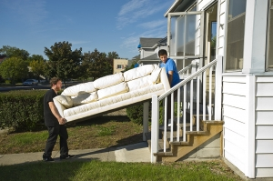 Ben Goutkovitch and Josh Stewart carry in a couch into their new home: Moishe House Royal Oak. (Photos by Jerry Zolynsky)
