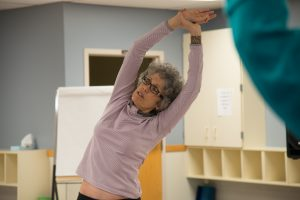Dr. Ruth Lerman leads a yoga session.