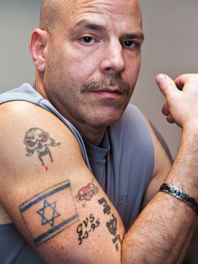 "Evan Sherman says, ""I figured if they could wear their swastikas and other hate stuff, then I can fly my colors."" One tattoo is of his mother's Hebrew name."