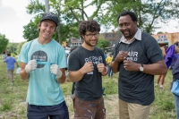 Repair the World fellow Joel Millman of Detroit and director of Repair the World Detroit Ben Falik of Huntington Woods with Tommy Hearns
