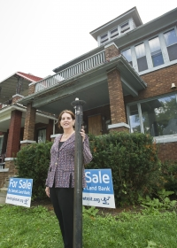 Erica Ward Gerson, head of the Detroit Land Bank, at one of the abandoned Detroit homes up for sale and rehab