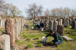 Volunteers work to beautify the cemetery.