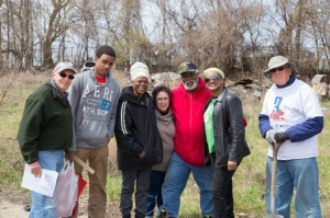 People from the neighborhood joined members of the Jewish community in cleaning up the cemetery.