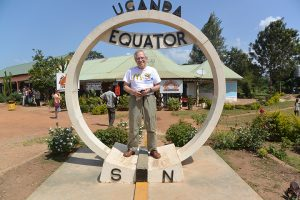 Jerry Knoppow stands at the equator in Uganda.