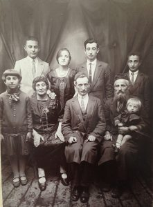 A family portrait, circa 1929, shows Perry Shulman's mother, Bayla, and father, Motle, standing in the center. Shulman, about a year old, sits on his grandfather's lap. When the Nazis invaded, Motle had been shot while still in Klimontow, Poland. After being deported in October 1942 and shuffled from camp to camp, Shulman was eventually separated from Bayla and 3-year-old brother Salik (Saul), while he and 10-year-old brother Moshe Mair, along with two uncles, remained together up to Birkenau. After he was in Detroit, Shulman found out that Bayla had been liberated from Bergen-Belsen and Salik from Auschwitz, and both were living in Toronto.