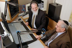 "Rabbi Herschel Finman, interviews Specs Howard (Jerry Liebman) for his ""chai anniversary"" show last March"