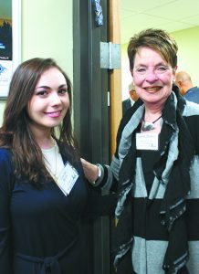 WSU student Chavivah Bluth poses with event chair Elaine Driker in front of the mezuzah Bluth made for HMD.