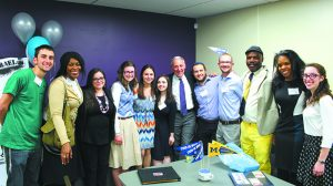 Eric Fingerhut, president/CEO of Hillel International, poses with some HMD students in the newly renovated space.