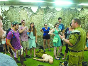 Birthright participants listen to an IDF soldier explain how they deal with medical emergencies in the field.