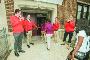 City Year Detroit members greet students every morning to get them excited about learning.
