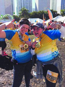 Ariella Shaffren and Rivka Jacobs after completing the Miami Half Marathon.