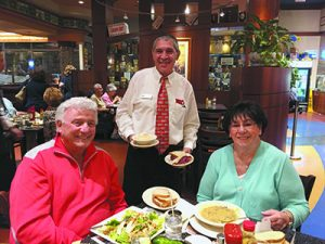 Former Detroiters Mel and Marilyn Rothenberg of Boca Raton flank Gerry Basila at dinner at Ben's.