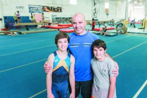 Leon Bekker in the gym with his sons Ari and Elan