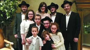 Itty Shemtov and her children: Mendel, 22, Levi, 20, Zelig, 18, Yisrolik, 16, Mussi, 14, Tzemach, 11, Chanale, 9, and Rochel and Meir, both 6.