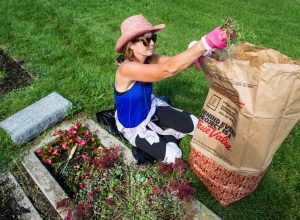 Ann Podolsky of Bloomfield Hills bags some weeds.