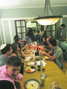Friends and members of Detroit City Moishe House and Moishe House Royal Oak celebrate Shabbat and the 10th anniversary of Moishe House