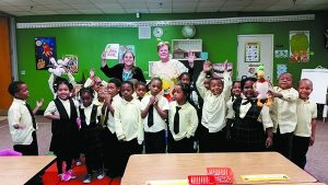 Teacher Lydia Paterni and author Jackie Urbanovic with Paterni's Coleman A. Young Elementary School kindergarten class from last year
