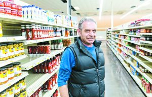 Grocer Jerry Denha stands in his new Noah's Marketplace, which will feature a wide selection of kosher food. He expects to open in early December.