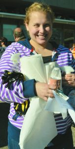 Volunteer Ariana Mentzel picks up supplies at this year's Fall Fix Up.