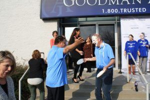 Attorney Gerald Acker takes a pie to the face for a good cause.