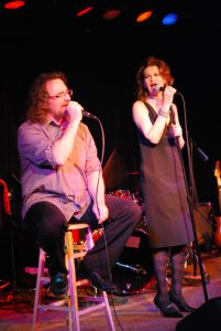 Shawn Colton and Sandra Bernhard belt out an REO Speedwagon song at the Ark.