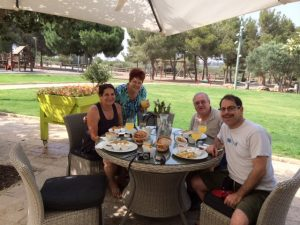 Visiting with Batya and Yisrael Rosenberg, former neighbors in WB, at breakfast in the Rothschild Gardens.