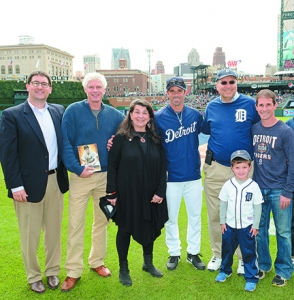 Jordan Field, left, stands with Tigers skipper Brad Ausmus, center, and others on Jewish Heritage Day at Comerica Park.