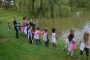 Preschoolers at Temple Israel in West Bloomfield take part in a tashlich ritual at the temple's pond in preparation for last year's Rosh Hashanah.
