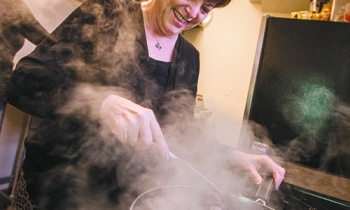 Judy Goldsmith browns meat to go into a cholent for Shabbat Kiddush at the Woodward Avenue Shul.